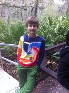 My son, happy on a class field trip to the environmental center  that I had to miss.